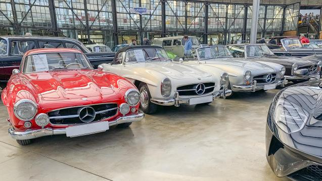 Mercedes SLs in a row, pricey red one on the left