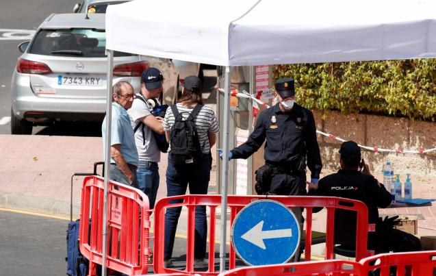 Tourists pass through a police checkpoint