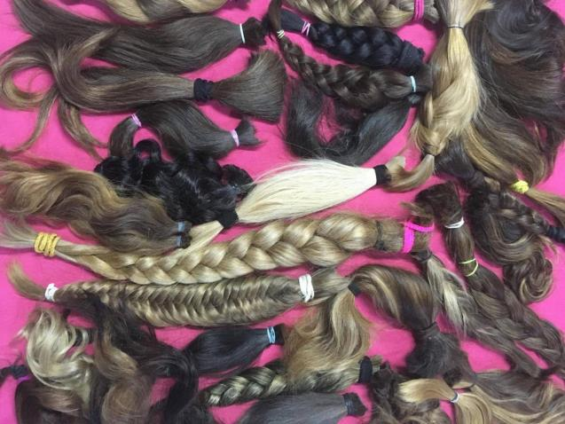 People donate hair to cancer charity for wigs