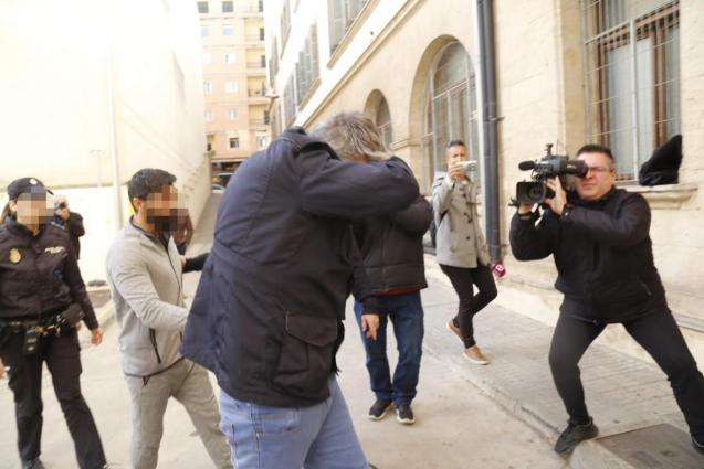 Carlos García Roldán covers his face when arriving at court on Wednesday