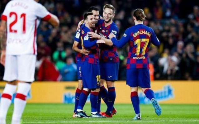 Leo Messi is congratulated by some colleagues