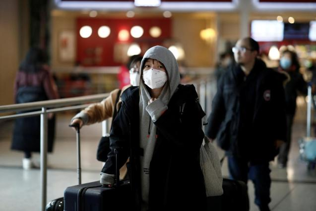 Many tourists are now wearing masks due to coronavirus