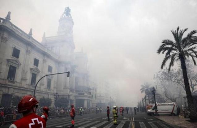 Valencia Town Hall in Plaza del Ayuntamiento wrapped in smoke during the Mascletá
