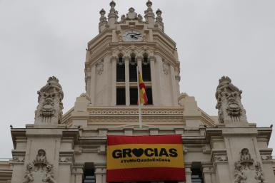 "Madrid City Council thanked the people of Madrid for their ""civic-mindedness in this serious health crisis"" with two flags displayed on the façade of the Palacio de Cibeles, one with the colours of the Spanish flag and a 'Thank you to all', and the other with the ribbon worn by the mayor, José Luis Martínez-Almeida, on his social networks."
