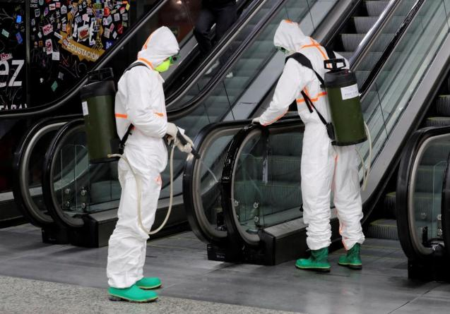 Members of the Military Emergency Unit (UME) disinfect Madrid Puerta del Sol metro to fight coronavirus.
