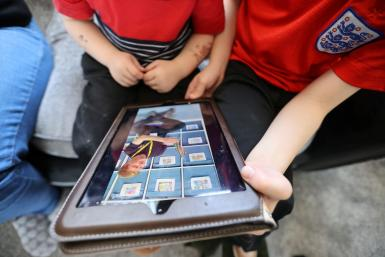 Children listen to stories on their nursey app during the C0VID-19.