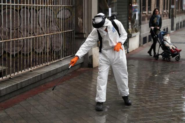 A municipal worker in protective gear