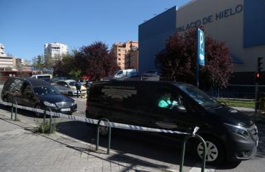 Hearses carrying corpses leave an ice rink, being used as a morgue, during the coronavirus disease (COVID-19) outbreak in Madrid, Spain, March 26, 2020.