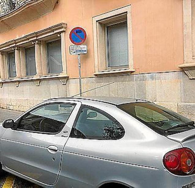 Car parked in an area reserved for loading and unloading.