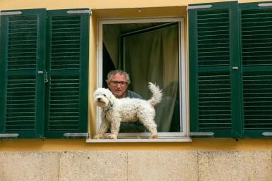 A man in Minorca confined to home with his dog.