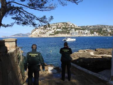Guardia Civil officers observing the catamaran.