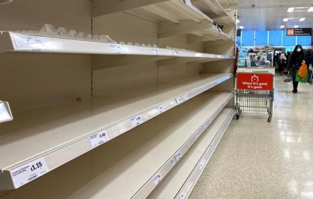 The shelves remain empty as people panic buy