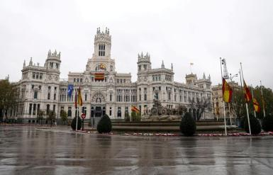 The Spanish flag flutters at half mast at Madrid's City Hall, during the coronavirus disease (COVID-19) outbreak, in Madrid, Spain March 31, 2020.