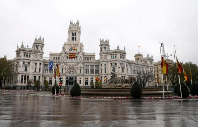 The Spanish flag flutters at half mast at Madrid's City Hall