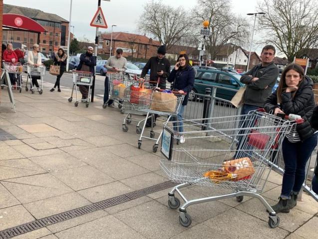 Supermarket queues during social distancing