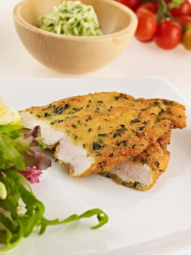 Lemon-herb crusted chicken schnitzels with tzatziki & salad leaves