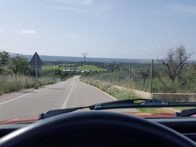 This is where we'd all like to be, behind the wheel, cruising in Majorca.