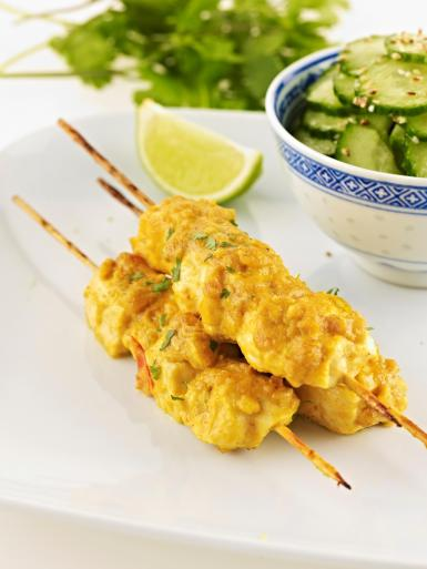 Chicken satay with seasme-cucumber salad.
