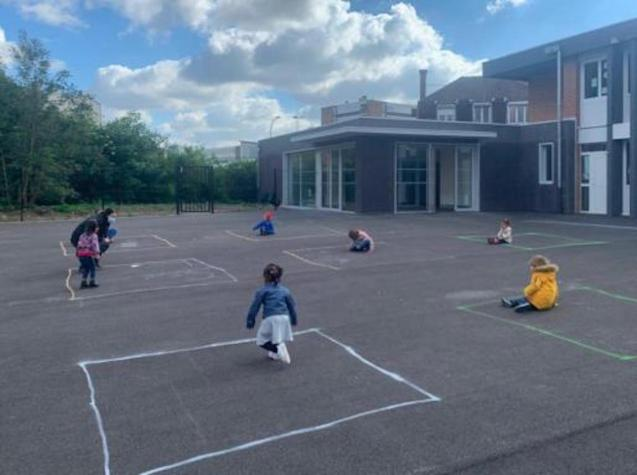 French children play together from individual chalk boxes.