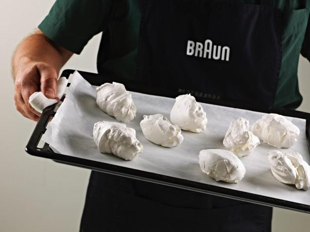 Confectioners sugar is the usual option for meringues as the small grains dissolve easily in the foamy mixture.