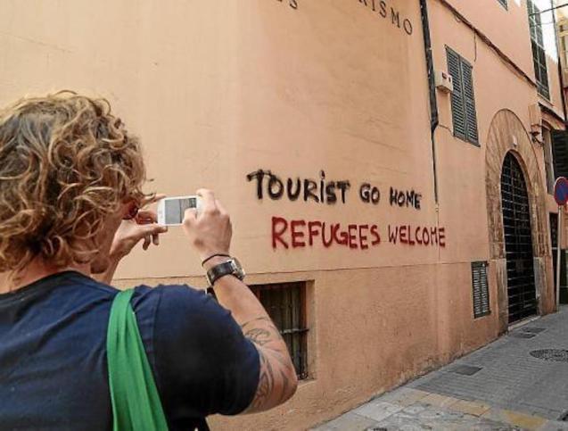 Graffiti on tourist accommodation in Palma.
