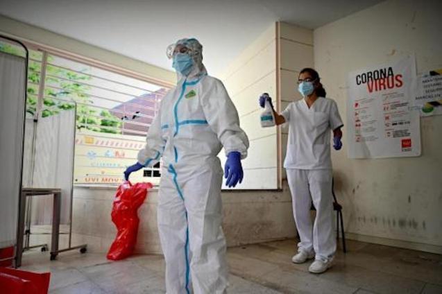 A doctor is disinfected after a consultation at El Torito de Moratalaz Health Centre.