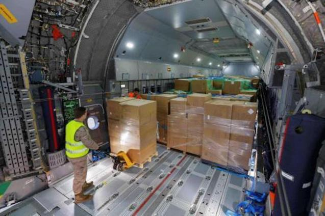 Medical supplies being unloaded from cargo plane in Majorca.