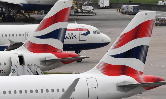 British Airways aircraft stand on their parking positions at Heathrow Airport in London.