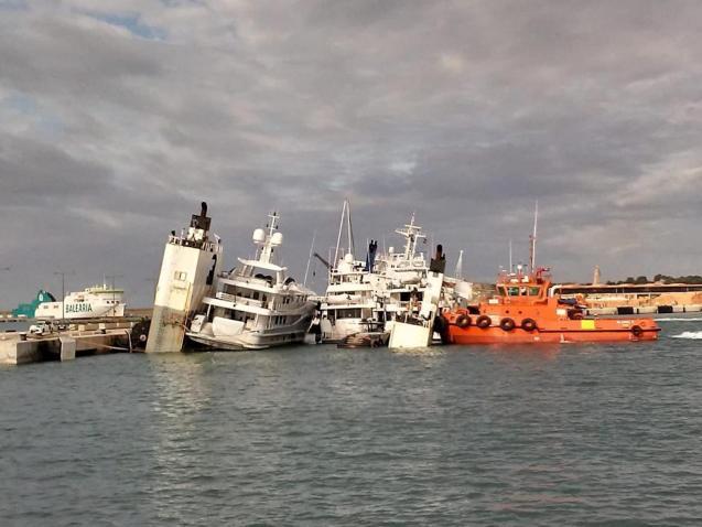 Cargo ship sinking in Palma harbour.