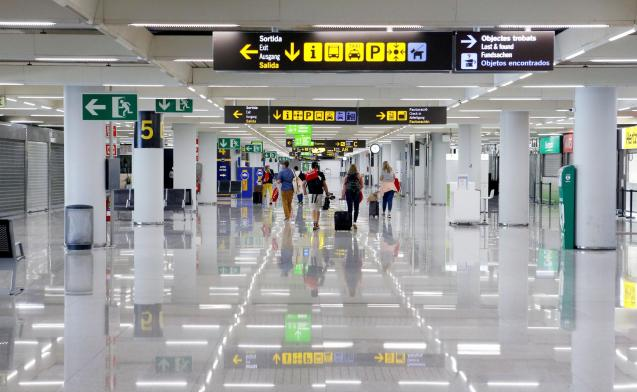 Passengers arrive at Palma airport.