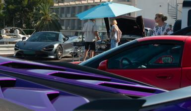 Supercars go to Calanova. Lamborghini foreground with sublime McLaren by Gordon Murray.