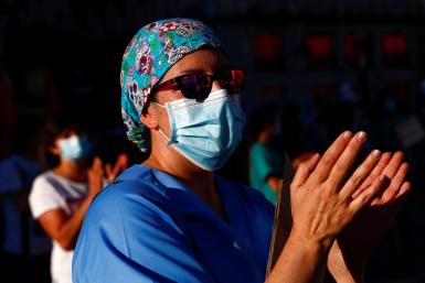 A healthcare worker gestures during a protest to demand the protection of Spain's public health system, amid the coronavirus disease (COVID-19) outbreak, in Madrid.