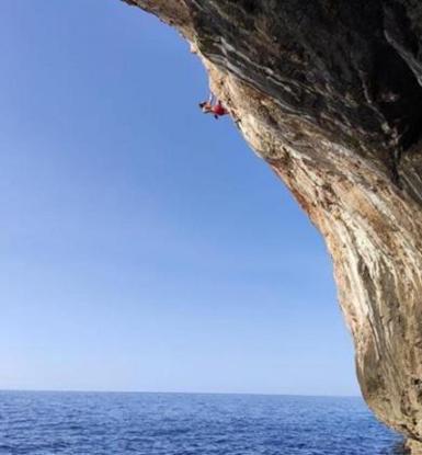 American climber, Chris Sharma practising psicobloc.