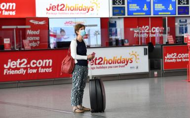 A passenger at Stansted Airport London.