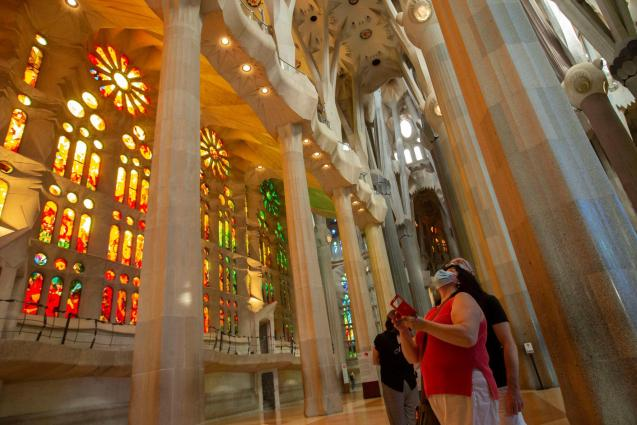 Health workers, police officers and NGO staff members with their families visit the Sagrada Familia basilica as it reopens following the coronavirus disease.