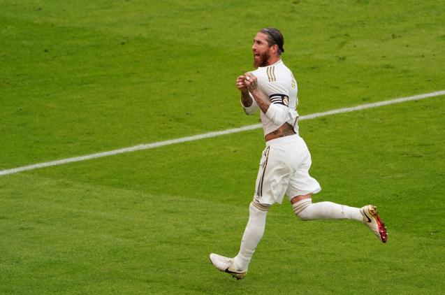 Real Madrid's Sergio Ramos celebrates scoring their first goal, as play resumes behind closed doors following the outbreak of the coronavirus disease.