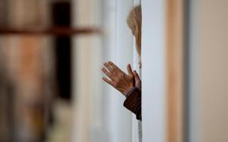 A woman clapping during the lockdown in Spain