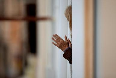 A woman clapping during the lockdown in Spain.