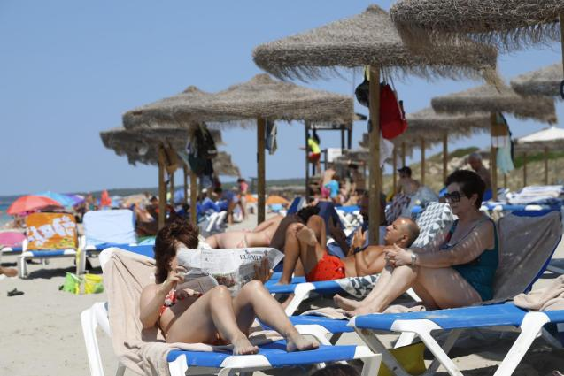 Tourists on the beach in Minorca