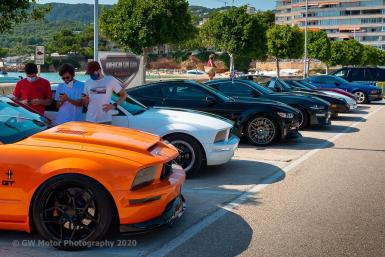 Some of the colourful American Car Club lined up at the start.