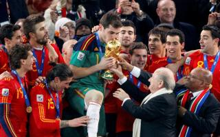 World Cup trophy to Spain's team captain Casillas during the award ceremony
