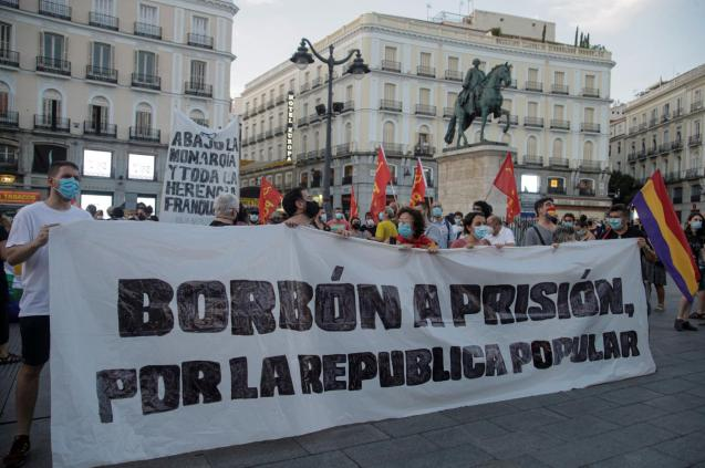 Protesters hold a banner during a protest against Spain's monarchy