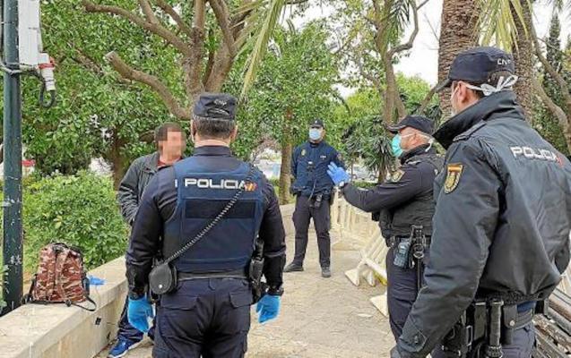 Police talking to a man in Palma during lockdown.