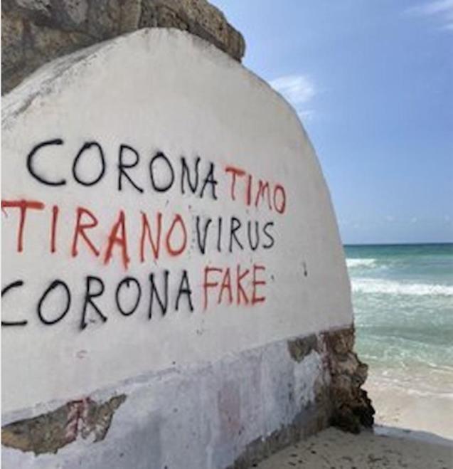Anti-Covid-19 graffiti in Es Trenc.
