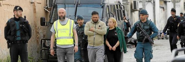 Guardia Civil & 2 detainees, Son Banya, Majorca.