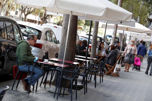 People sit on a terrace in Barcelona