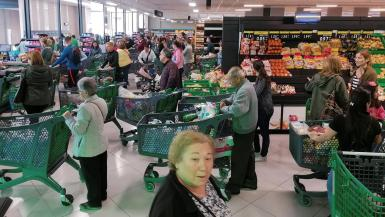 People shopping at the supermarket.