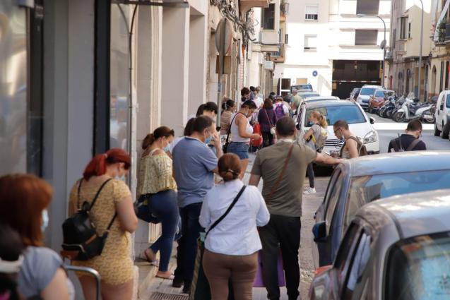 People queuing for soup kitchen in Palma, Mallorca