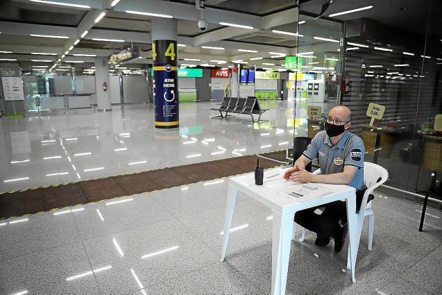 Security guard at an empty Palma Airport.