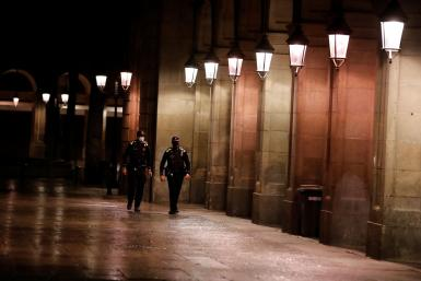 Police officers patrol during the first day of the night-time curfew set as part of a state of emergency in an effort to control the outbreak of the coronavirus disease (COVID-19), in Barcelona.